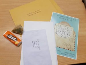 Envelope, paper, biscuit and teabag for Letters to Myself project